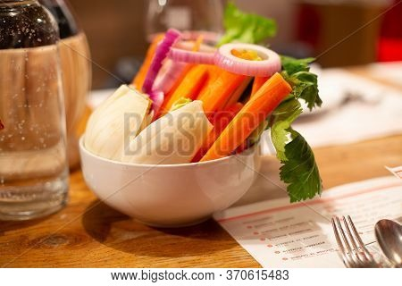 Vegan Buddha Bowl. Bowl With Fresh Raw Vegetables - Radish, Carrot, Ognion, Radish, Green Parsley In