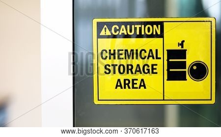 Black-yellow Chemical Storage Area Hazard Sign And Symbol On The Glass Door, Caution For Warning Dan