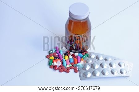 Ferrous Fumarate Pills, Blister Packs With Color Tablets, Capsules, Vitamins In Brown Bottle For Tre