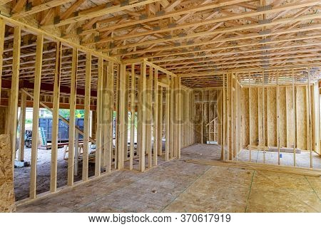 Wooden House Building Frame Structure On A New Development Framing Of Under Construction