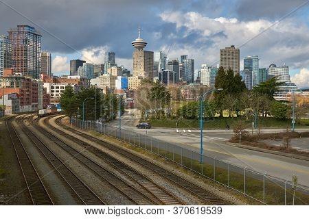 Downtown Vancouver Skyline And Railway Tracks. Downtown Vancouver Skyline With Rail Lines Moving Com