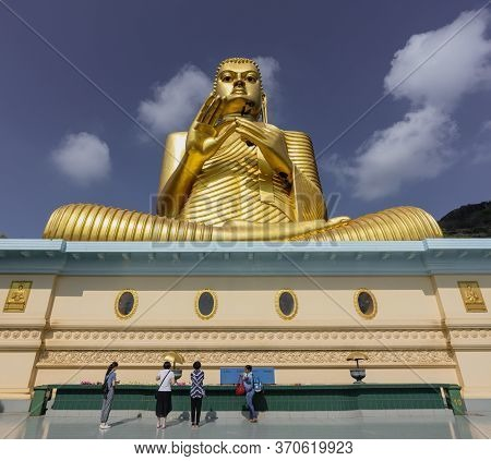Kandy, Sri Lanka - 09-03-24 - Giant Golden Buddha Statue At Golden Temple Of Dambulla In Sri Lanka.