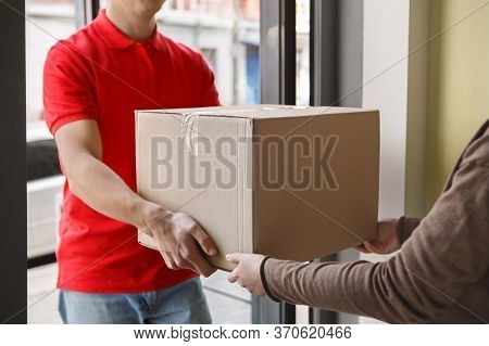 Order Received. Woman Receives Big Cardboard Box From Courier At Home, Free Space