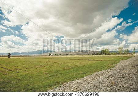Beautiful View Of A Expressway Against The Backdrop Of A Mountain Landscape And A Blue Sky With Clou