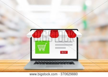 Shopping Online And E-commerce Marketing Concept : Shopping Shop Store  And Shopping Cart Icon On La