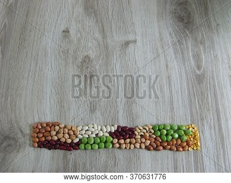 Different Types Of Legumes - Beans On Wooden Background. Pinto Beans, Black-eyed Peas , Cheakpeas, Y