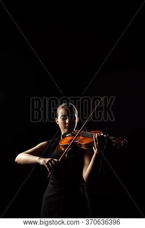 Professional Musician Playing Symphony On Musical Instrument Isolated On Black