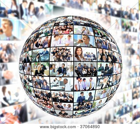 A globe is isolated on a white background with many different business people