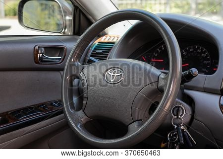 Novosibirsk/ Russia - May 03 2020:  Toyota Camry,auto Interior: Steering Wheel With Red Logo  Toyota