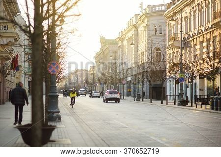 Vilnius, Lithuania - April 10, 2020: Townspeople And Tourists Strolling On The Gedimino Avenue, One