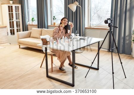 Full Length Shot Of Female Blogger Recording A Tutorial Video For Her Beauty Blog About Skincare Rou