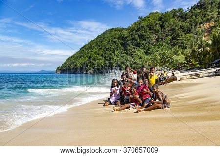 Papua New Guinea, Jayapura, August, 15, 2019 - Indonesian Funny Children Are Photographed With A Whi