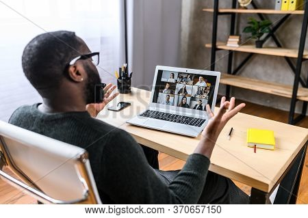Virtual Meeting With Many People Together. African-american Young Guy Talking Online With Employees
