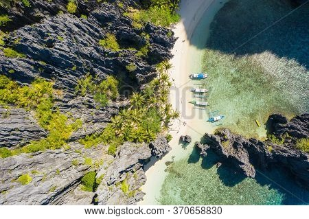 El Nido, Palawan, Philippines, Top Down Bird Eye Aerial View Of Boats And Cliffs Rocky Mountains Sce