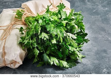 Parsley On A Gray Background, Eco-friendly Parking, Food Delivery, Copy Space Fresh Green Parsley.
