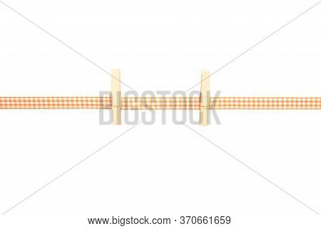 Colorful And Crisp Image Of Background With Orange-white Checkered Ribbon And Pegs