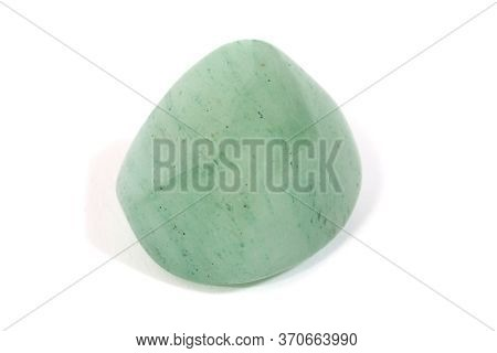 A Green Aventurine Gemstone Against A White Background