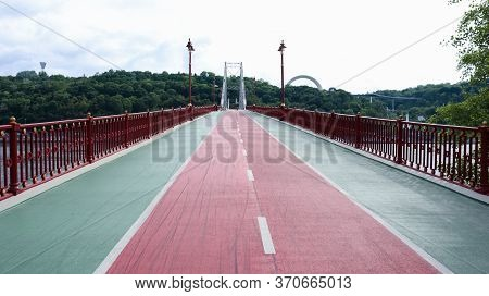 Park Pedestrian Bridge Over The Dnieper River, Which Connects The Central Part Of Kiev With The Park