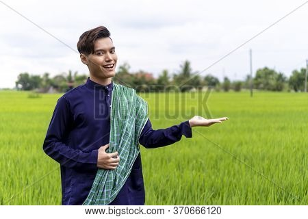 Malaysian Guy Wearing Traditional Cloth Outdoor