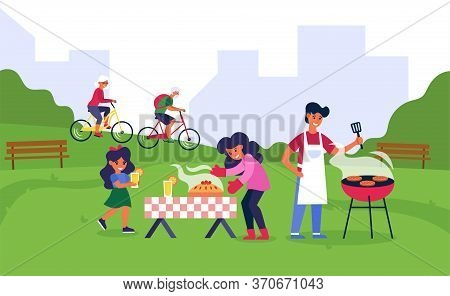 Family Having Barbeque In Public Park. Man Grilling Steak And Woman With Daughter Arranging, Table F