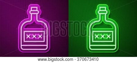 Glowing Neon Line Alcohol Drink Rum Bottle Icon Isolated On Purple And Green Background. Vector
