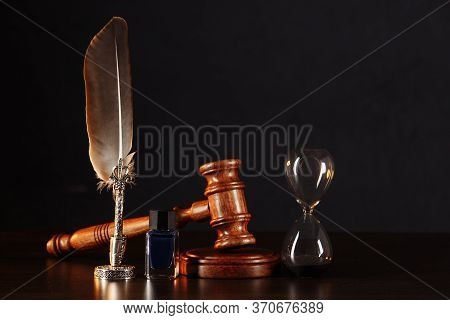 Hourglass, Notarys Public Pen, And Stamp On Testament And Last Will On The Wooden Table. Notary Publ