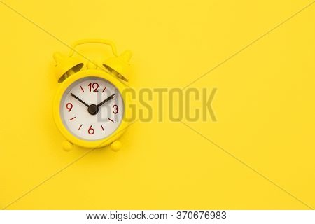 Yellow Alarm Clock Isolated On Yellow Trendy Background. Rest Hours Time Of Life Good Morning Night