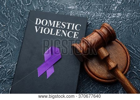Domestic Violence Law And Gavel On Grey Table