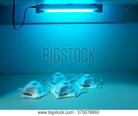 Protection And Safety Of Medical Workers.protective Masks N95 Are Sterilized Under Ultraviolet Light