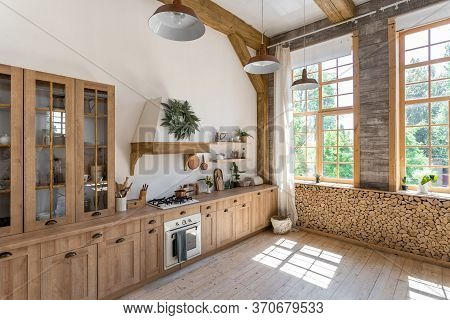 Comfortable Light Kitchen Room With Modern Interior, Large Windows, Wooden Furniture, Gas Stove, Ove