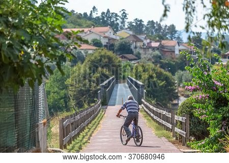 Viseu / Portugal - 10 05 2018: Eco View Pedestrian / Cycle Lane, With Senior Man Cycling And Pedalin