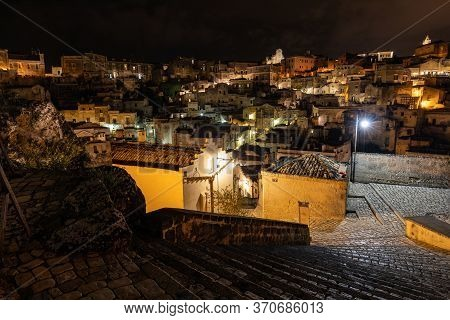 Amazing Lighted Buildings In Ancient Sassi District By Night In Matera, Well-known For Their Ancient