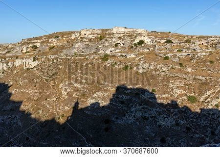 View Of Gravina River Canyon And Park Of The Rupestrian Churches Of Matera With Houses In Caves Di M