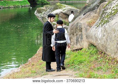 September 23, 2018. 2 Boy, A Family Of Hasidic Jews, Walk In The Park In Uman, Ukraine, Jewish New Y