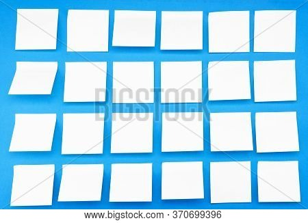 A Lot Of Blank Yellow Stickers On A Blue Background. Side View