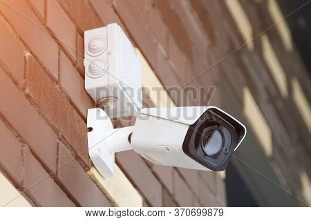 Closed-circuit Television Camera Mounted On Brick Wall. Cctv Security Camera Outdoors.