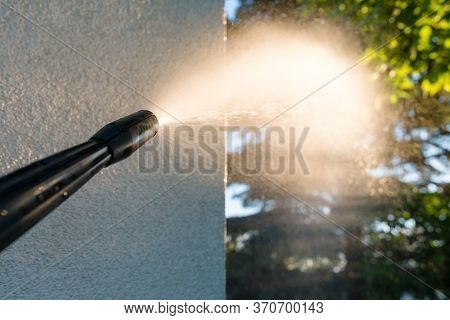 Power Washing The Wall - Cleaning The Facade Of The House - Focus On The Tip Of The Spray Nozzle- Sh