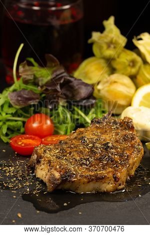 Dinner Prepare Pork Steak Grilled In Olive Oil And Herbs Is A Popular Food In Europe. Salads With Le