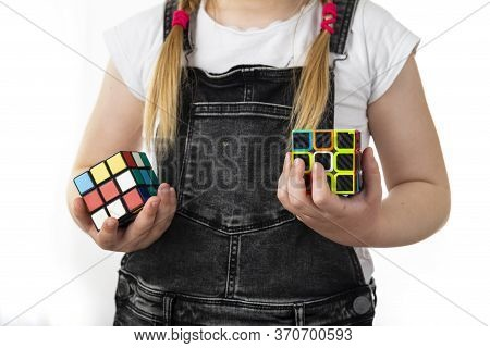 Minsk, Belarus, June 9, 2020: Rubiks Cube In The Hands Of A Little Girl. A Child Holds A Rubiks Cube