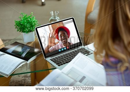 Businesswoman Participate Video Conference Looking At Laptop Screen During Virtual Meeting, Videocal