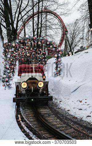 Copenhagen / Denmark - November 2019: Christmas Theme Decorated Train In Tivoli Gardens Rollercoaste