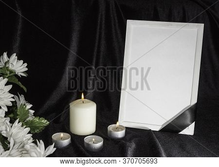 The Concept Of Wake. Candles And White Flowers On A Black Background. Funeral Frame With Free Space