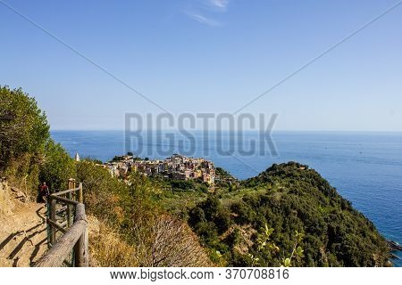 Cinque Terre, Italy - July 8, 2017: View Of Corniglia From The Hiking Trail To Vernazza On A Sunny D