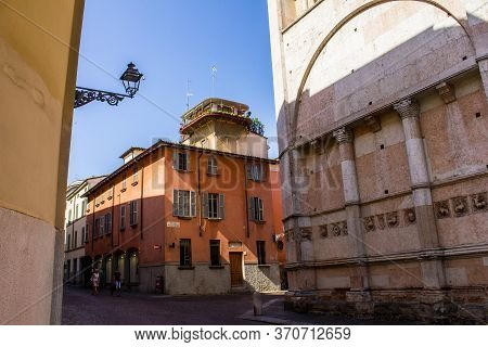 Parma, Italy - July 8, 2017: People Walking Near Parma Baptistery In Piazzale Del Battistero On A Su