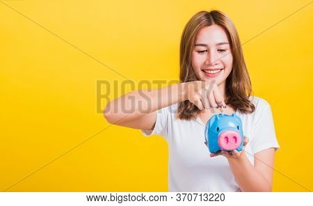 Portrait Asian Thai Beautiful Happy Young Woman Smiling Save Money By Dropping Coin To A Piggy Bank