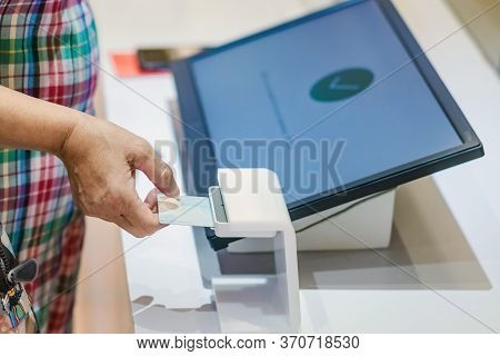 Close Up To Woman Use The Identification Card Inserted Into The Identity Verification Machine To Rec