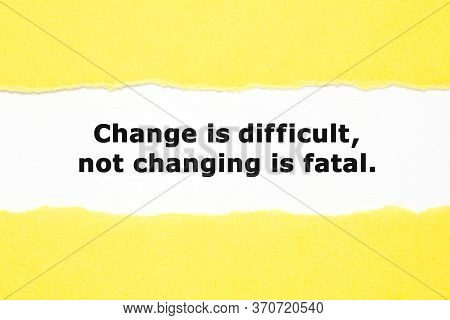 Motivational Quote Change Is Difficult Not Changing Is Fatal Appearing Behind Torn Yellow Paper. Ada