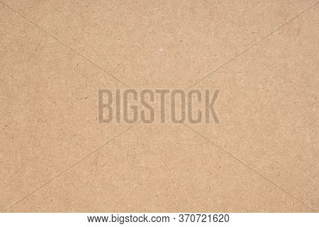 Texture of brown craft or kraft paper background, cardboard sheet, recycle paper, copy space for tex
