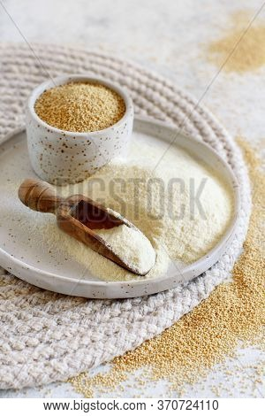 A Plate Of Raw Amaranth Flour With A Scoop And A Bowl Amaranth Seeds Close Up