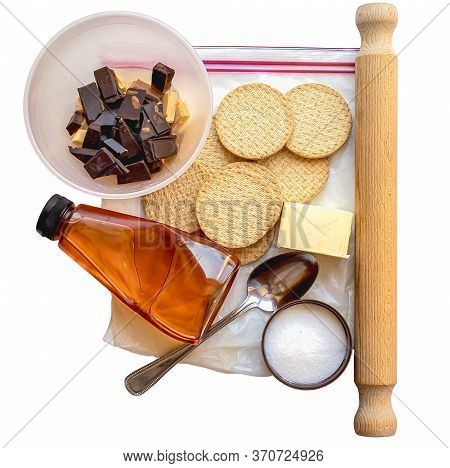 Top Down View Of The Equipment And Ingredients For Making Chocolate Praline Isolated On A White Back